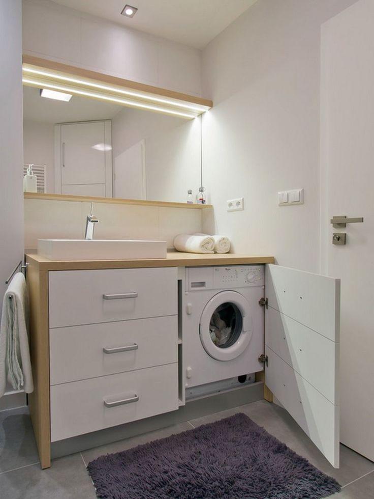 meuble pour machine à laver en bois et blanc qui abrite à la fois le lavabo et le lave-linge