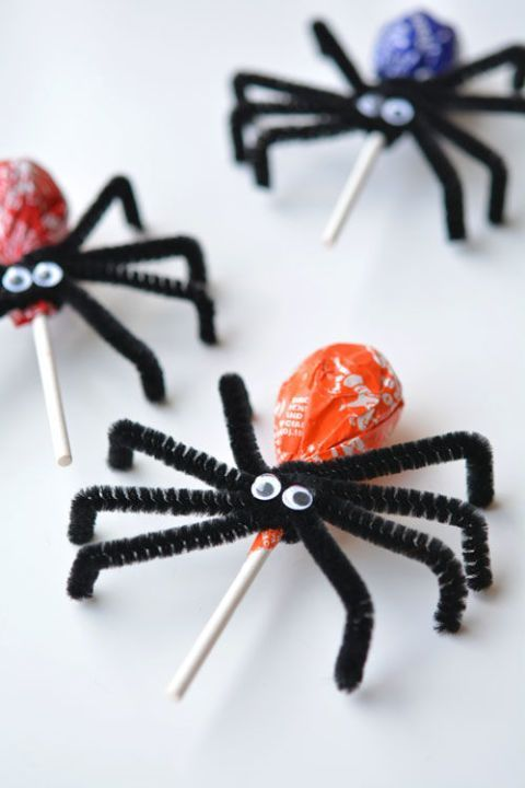 If you want to give trick-or-treaters a little something extra, attach pipe cleaners and googly eyes to make these Lollipop Spiders.