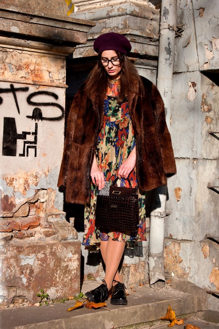 Shop this look on Lookastic:  https://lookastic.com/women/looks/fur-coat-midi-dress-oxford-shoes/15439  — Burgundy Beret  — Brown Fur Coat  — Dark Brown Leather Satchel Bag  — Black Chunky Leather Oxford Shoes  — Multi colored Floral Midi Dress