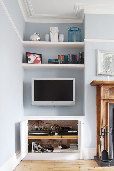 Sky Eye, TV Cupboard and shelf built into picture rail.