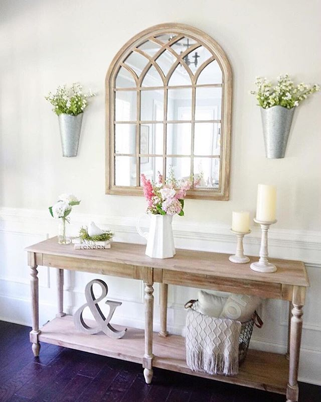 Take #interiordecorating advice from @myneutralnest: go with your gut and don't rush it. She just redecorated her #entryway and lightened it up with our Sadie Arch Mirror! We can all probably agree that it looks gorgeous! Click the link in our profile to see if the natural, cream or turquoise versions are available at your local store. #myKirklands #walldecor #springdecor