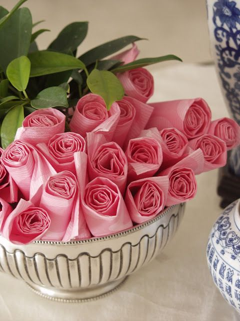 Party idea: roll up pink napkins to look like a basket of roses!