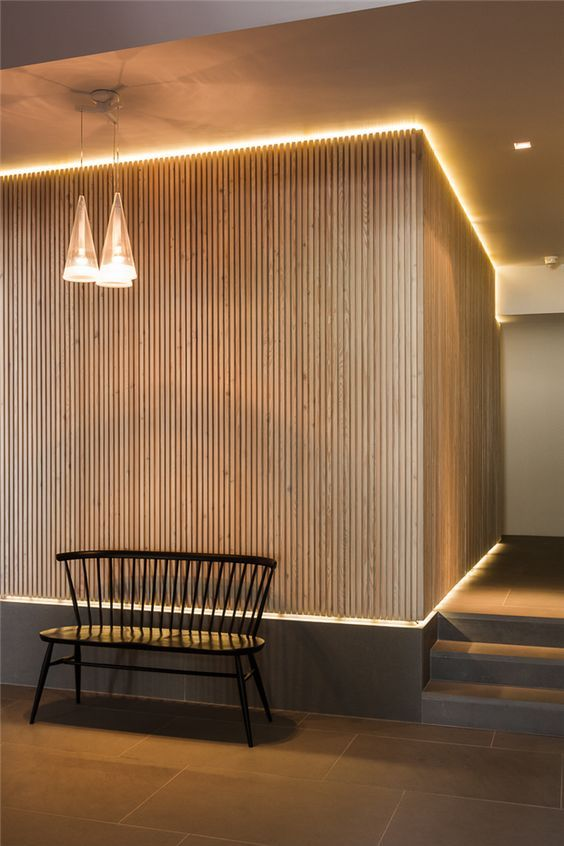 Timber feature wall with LED lights in this London private residence   designed by Atrium Lights & David Mikhaim Architects