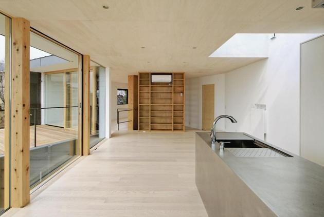 steep-slope-house-with-bookshelf-lined-interior-5-kitchen.jpg