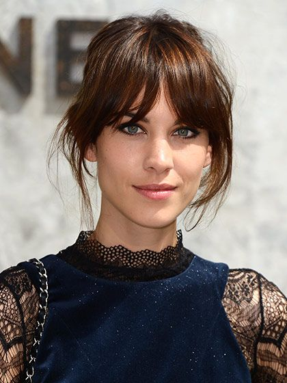 The all-time best celebrity bangs: Alexa Chung's long, center-parted bangs and beautifully blended layers from 2013 Paris Fashion Week were so good we almost forgot how much we love her cat-eye liner. Almost