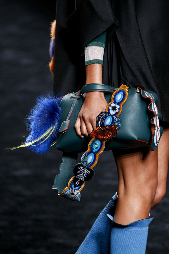 Fendi bag with a blue fur puff ball. That strap would be nice for a camera too!  <3 @benitathediva