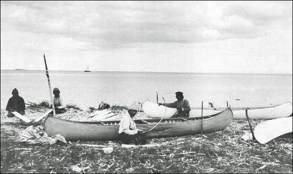 Innu making canoes near Sheshatshiu, ca. 1920. Photo by Fred C. Sears. (BW copy)