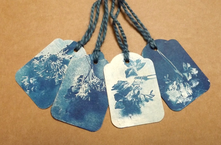 LYNNETTE MILLER: Cyanotypes At Last. Cyanotype gift tags with indigo dyed thread.