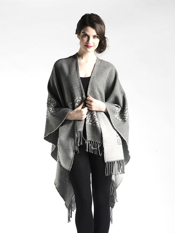 Oversized Outerwear Shawl with Fringe in Grey - A beautifully soft fabric, this oversized shawl can be worn as a cape or bundled up!  With beautiful animal pattern in the grey or colour blocked with neutrals in the black, you'll love how easy this piece is to throw over your shoulders as you're hurrying out the door! Available in Black and Grey