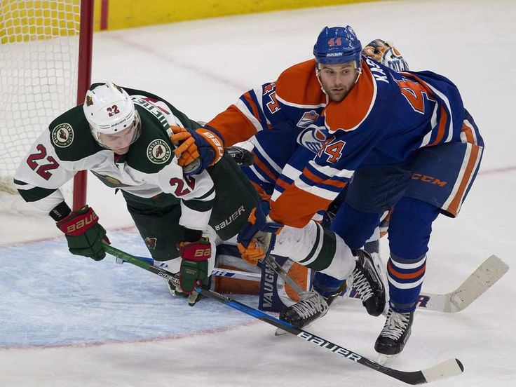 Edmonton Oilers Zack Kassian (44) pushes Minnesota Wild's Nino Niederreiter (22) to the ice during third period NHL action on Sunday, December 4, 2016 in Edmonton. Greg Southam / Postmedia (To go with a sports story.) Photos off Oilers game for multiple writers copy in Dec. 5 editions.