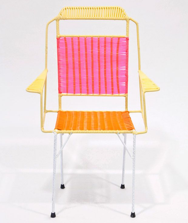 Marni collection of 100 colorful wicker chairs made by ex-convicts in Colombia, constructed from metal frames with multi-colored PVC threads woven around the seat backs and armrests. The style of seat is traditionally Colombian, updated with Marni's reinterpretation of the woven pattern to create new color variations in line with the Milanese fashion house. They've also added small tables to go alongside the chairs  indoors or out.