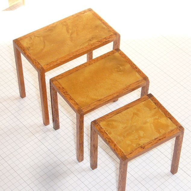 "Nesting tables Ashwood veneer and mahogany trim. H 2"" x L 2 1/4"" x W 1 1/4"" For sale at www.aegminiatures.com"