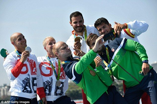 The Great Britain, Spain and Lithuania pairs celebrate with a podium selfie in…