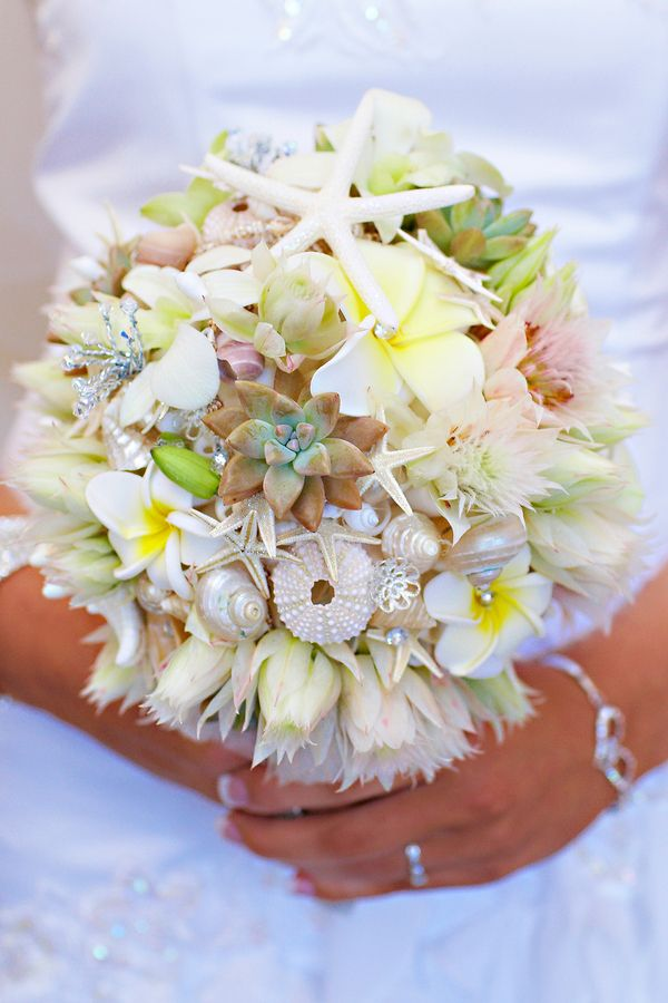 Barefoot Casual Beach Wedding in Forster NSW by Bella Photo Art - bridal bouquet accented with shells and starfish