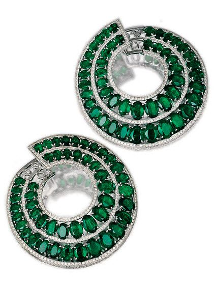 PAIR OF EMERALD AND DIAMOND EARRINGS, MICHELE DELLA VALLE. Each of hoop design, set with two lines of graduated oval emeralds, each bordered by lines of brilliant-cut diamonds, mounted in white gold, signed MdV and numbered, fitted case.