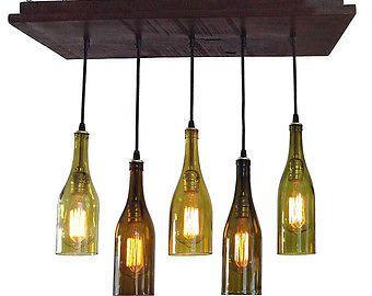 lumières de plafond avec bouteille de vin. mon prix est de $29.00 chaque bouteille pot mason etc. même prix vous pouvez choisir le design. il faut venir a mon atelier pour choisir. on peut mélanger les couleurs et les modèles de bouteilles de boisson. prix en fonction du modèle choisie. les ampoules ne sont pas incluses.