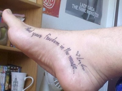 """""""Find your Freedom in the music -Lady Gaga"""" foot arch tattoo."""