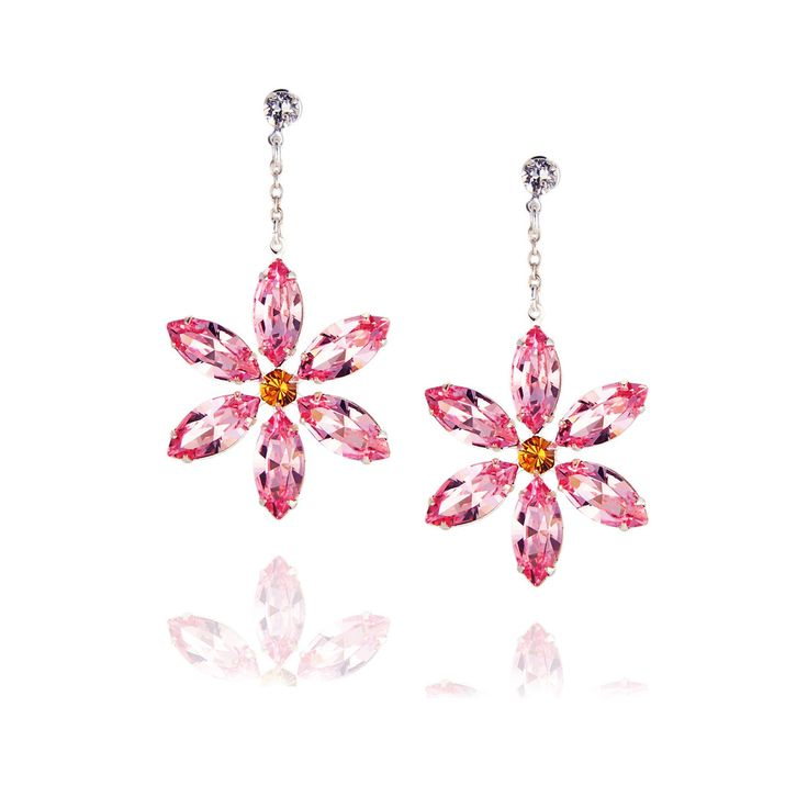Dazzling Swarovski crystal flower earrings with a sparkling Swarovski crystal stud.  Each facet of each petal reflects light, creating brilliant radiance and effortless glamour.   Available in a range of colours.  www.jyjewels.com