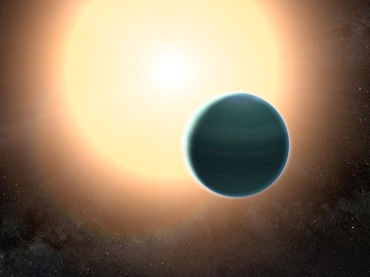 The atmosphere of the Neptune-mass exoplanet HAT-P-26b is unexpectedly primitive, composed primarily of hydrogen and helium. By combining observations from Hubble and Spitzer space telescopes, Wakeford et al determined that, unlike Neptune and Uranus, the exoplanet has relatively low metallicity. Image credit: NASA's Goddard Space Flight Center.