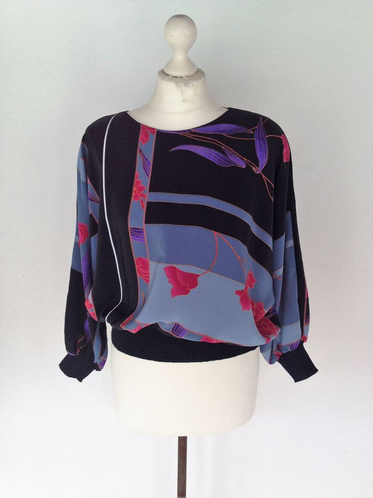 Excited to share the latest addition to my #etsy shop: vintage 80s Ladies Black Batwing Top, Blue Pink And Purple Flower Pattern, Long Sleeve Blouse, Kitsch Top, Floral Top, Retro, Size 10 12UK http://etsy.me/2HKQigf #clothing #women #blouse #black #blue #vintageblouse