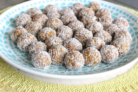 Raw Carrot Cake Balls Recipe Desserts with unsweetened shredded dried coconut, medjool date, nuts, carrots, hemp seeds, pure vanilla extract, ground cinnamon, ground nutmeg, salt, ginger root