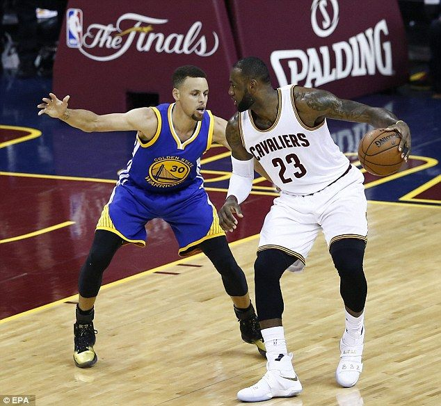 James put on one of his best performances for the Cavaliers and is seen trying to get past Curry (left)