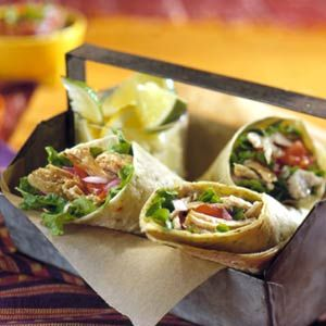 Cuban Pork Shredded tender pork and onions made in the slow cooker stuff these tortilla wraps. Top with fresh pico de gallo and avocado dip.