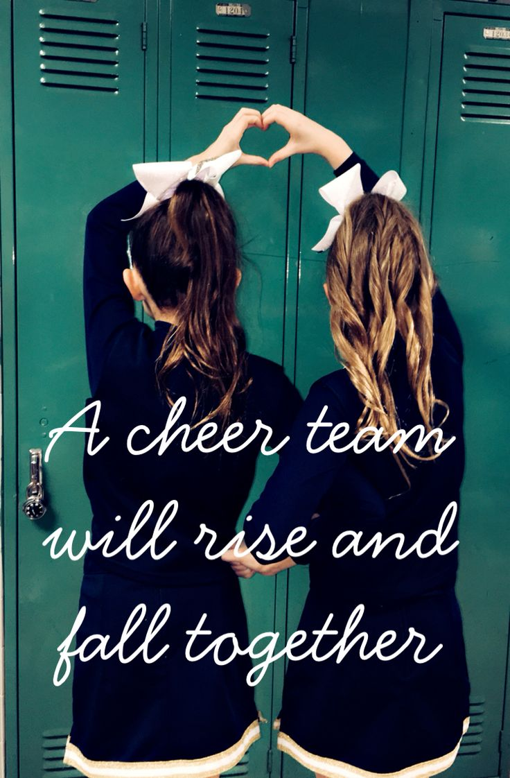 """A cheer team will rise and fall together"" this is a picture of me and my friend at a cheer competition"
