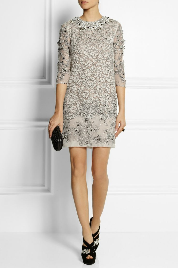BIYAN Lisbeth embellished lace dress $2,625 Hand-embroidered with glittering Swarovski crystals and beads, Biyan's dress showcases the brand's flair for craftsmanship and intricate embellishment. This delicate off-white lace design is cut for a slightly loose, flattering fit and is lined with a nude slip. Shown here with: Marni ring, Miu Miu shoes, Bottega Veneta clutch.