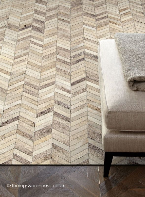 This Gaucho Chevron Rug (handmade, 100% cowhide leather) at first glance looks like parquet flooring .http://www.therugswarehouse.co.uk/leather-rugs/gaucho-chevron-rug.html