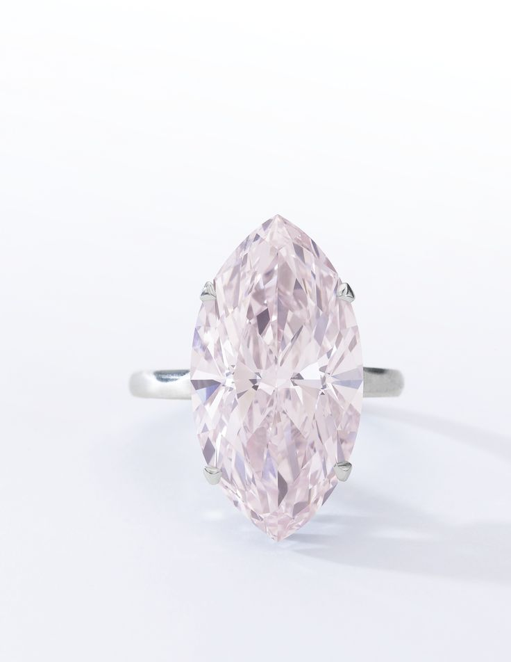 VERY FINE FANCY PINK DIAMOND RING Claw-set with a marquise-shaped fancy pink diamond weighing 12.07 carats, size 52.