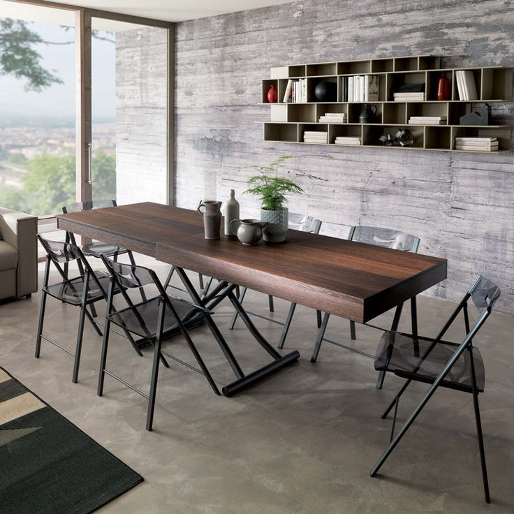 The Passo is a transforming coffee table that lifts and extends into a dining table thanks to a unique telescoping mechanism and self storing leaf.