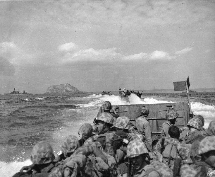 Assault on the beachhead, Iwo Jima, 1945.  Photo caption: Iwo Jima February 19, 1945. Marine-laden assault craft head to the beach at Iwo Jima during the initial landings on D-day. Note Mount Suribachi looming in the left background.   From the Photograph Collection at the Marine Corps Archives and Special Collections   OFFICIAL USMC PHOTOGRAPH