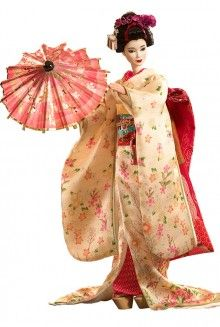 """Maiko Barbie Doll. This doll is wearing a Japanese Kimono. """"The kimono is a Japanese traditional garment worn by men, women and children. The word """"kimono"""", which literally means a """"thing to wear"""" (ki """"wear"""" and mono """"thing""""), has come to denote these full-length robes. The standard plural of the word kimono in English is kimonos, but the unmarked Japanese plural kimono is also sometimes used."""""""