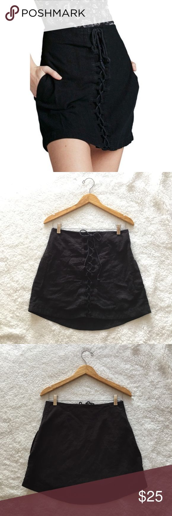 """Free People Walk My Way lace up mini skirt I do NOT model or trade. Please do not ask. -RTP $88, sold out. -Size Small, fits 1/2 larger. -Short-and-sweet mini skirt loaded with look-at-me edge thanks to alluring lace-up detail and a thigh-grazing silhouette. Fully lined. Two hidden side pockets. Secure hidden button closure. -Only flaw is light piling. -55% linen, 45% cotton.   •waist (lying flat): 14.5"""" •length: ~15.5"""" Free People Skirts Mini"""