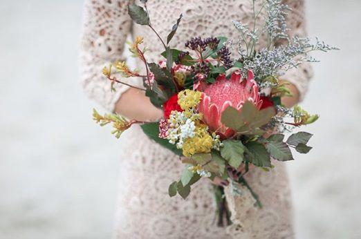 An exquisite brown wedding dress for a bohemian New Zealand beach wedding