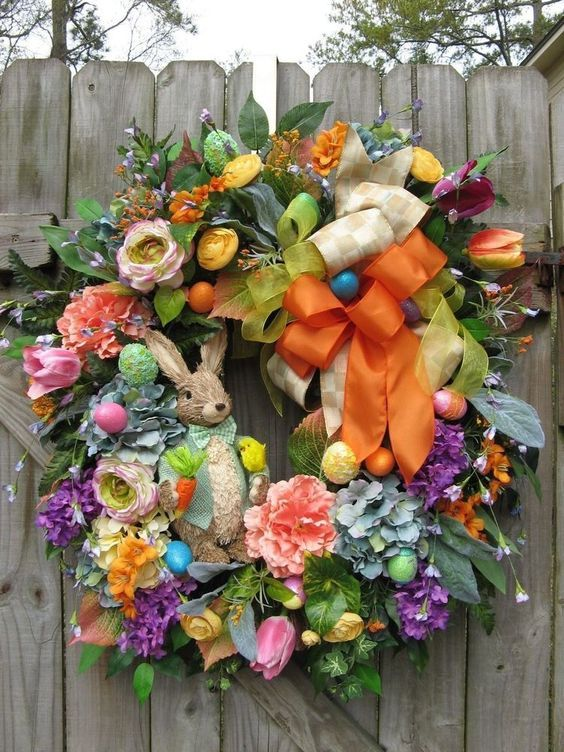 """Mr. Hopper's Egg Hunt"" ~ 30"" diam spring or Easter door wreath loaded with silk flowers, ribbons, & sisal rabbit figure at center ~ $200 