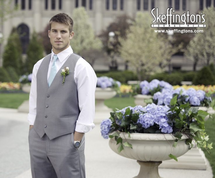 Blue long tie with gray suit pants and gray suit vest. Summer Wedding looks for Casual Grooms. Vintage feel. Suit pant with matching suit vest.