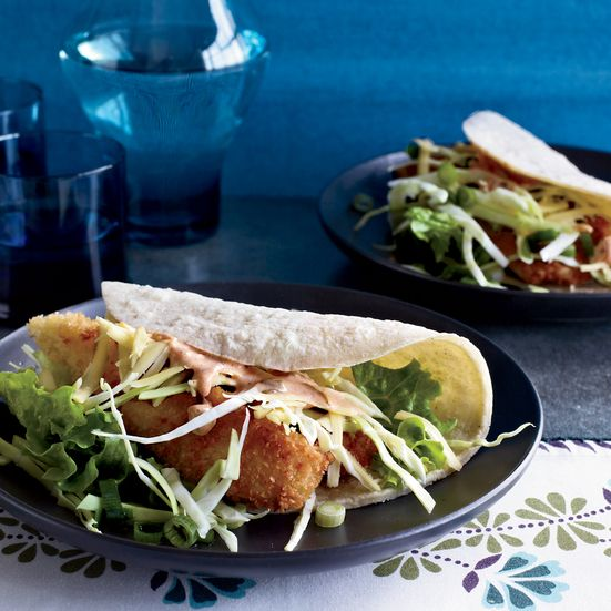 These fried-fish tacos use panko crumbs for an extra crisp crust on the fish. Hoisin mayonnaise, cabbage, lettuce, and scallions add extra flavor and crunch.