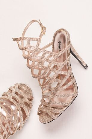"Make a sparkling statement in these glittering cage sandals with leg-elongating high heels.  By Qupid  Synthetic  4 1/4"" heel  Adjustable buckle  Imported  Fits true to size"