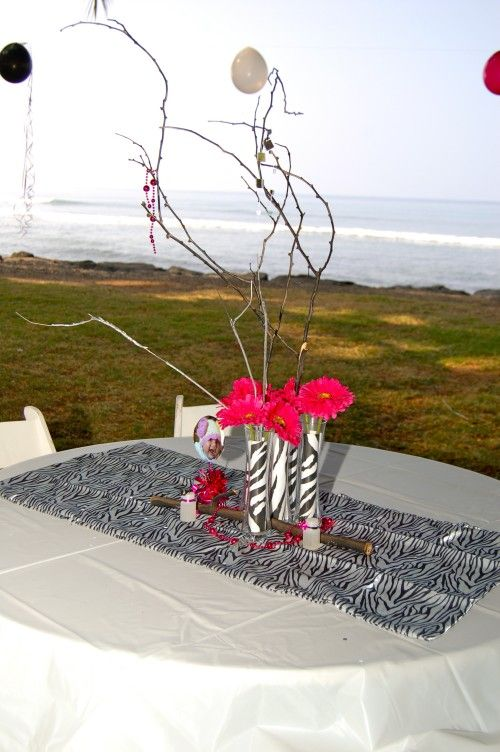 Zebra Centerpieces & Table Decorations. Instead of zebra could do chevron I have tons of sticks that we could paint pinks and white