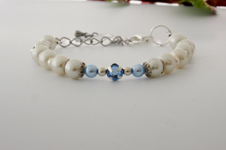 Silver bracelet with light blue and ivory pearls. Pearl bracelet, blue bracelet, ivory bracelet. 18,90 euro. http://bit.ly/fedarojewelry