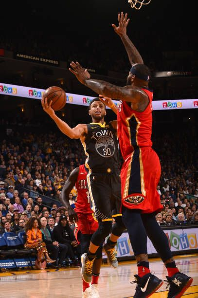Stephen Curry of the Golden State Warriors goes to the basket against the New Orleans Pelicans on November 25 2017 at ORACLE Arena in Oakland...