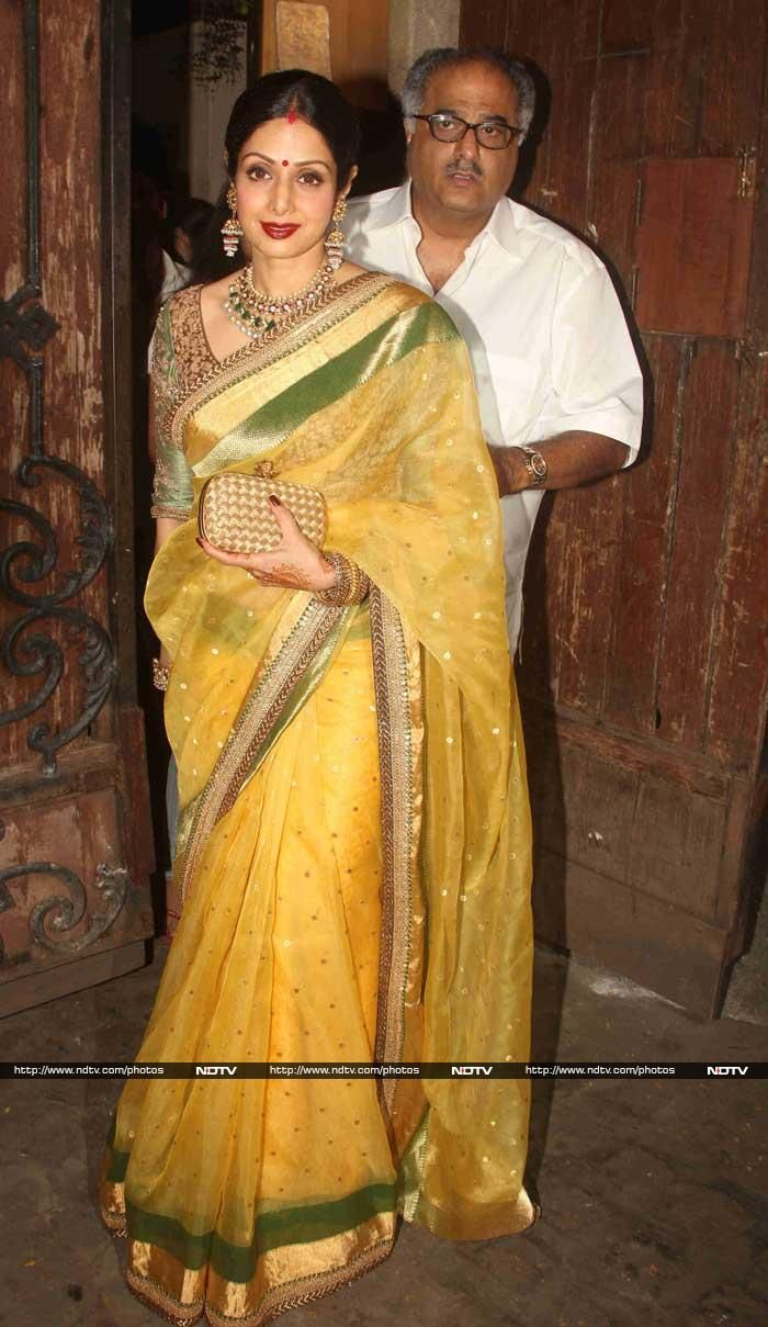 Ravishing in a yellow Sabyasachi sari and a green embroidered blouse, with jhumkas, a heavy necklace and flowers in her hair, Bollywood actress Sridevi was the cynosure of all eyes at the Karva Chauth celebrations held at her brother-in-law Anil Kapoor's residence in Mumbai on October 11.