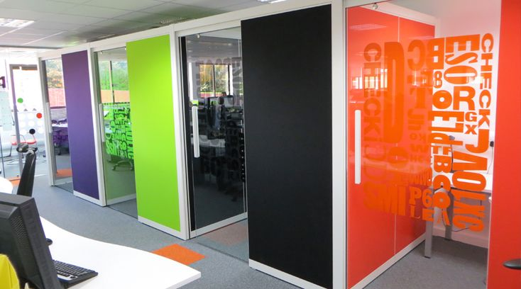 Coloured cut vinyl applied to office partition glass. These funky window graphics create an exciting colourful office atmosphere. By Space3.co.uk