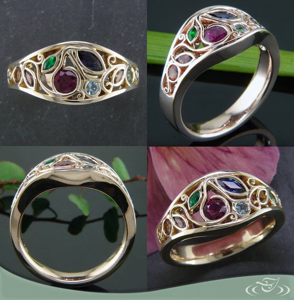 Custom #MothersRing in gold with an organically scattered assortment of birthstones: From left to right there is citrine, garnet, emerald, ruby, alexandrite, aquamarine, citrine, and peridot. #GreenLakeMade