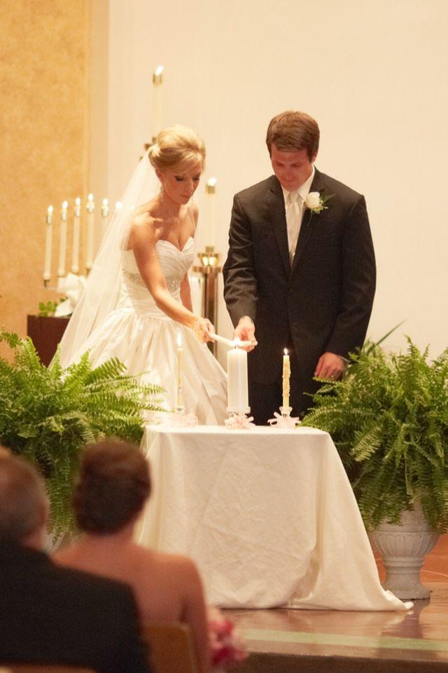 Catholic wedding Bride and groom using their baptism
