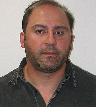 Tony Mokbel ... fugitive drug boss who vanished in March 2006 during his trial for cocaine  smuggling. Being hunted by Australian Federal Police and Interpol in 184 countries, he  was jailed in absentia for 12 years. A hitman has Mokbel and Carl Williams split a  $150,000 fee to have Lewis Moran killed.