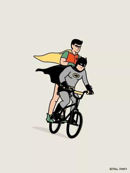 Batman and Robin ride a bat-mo-bicycle