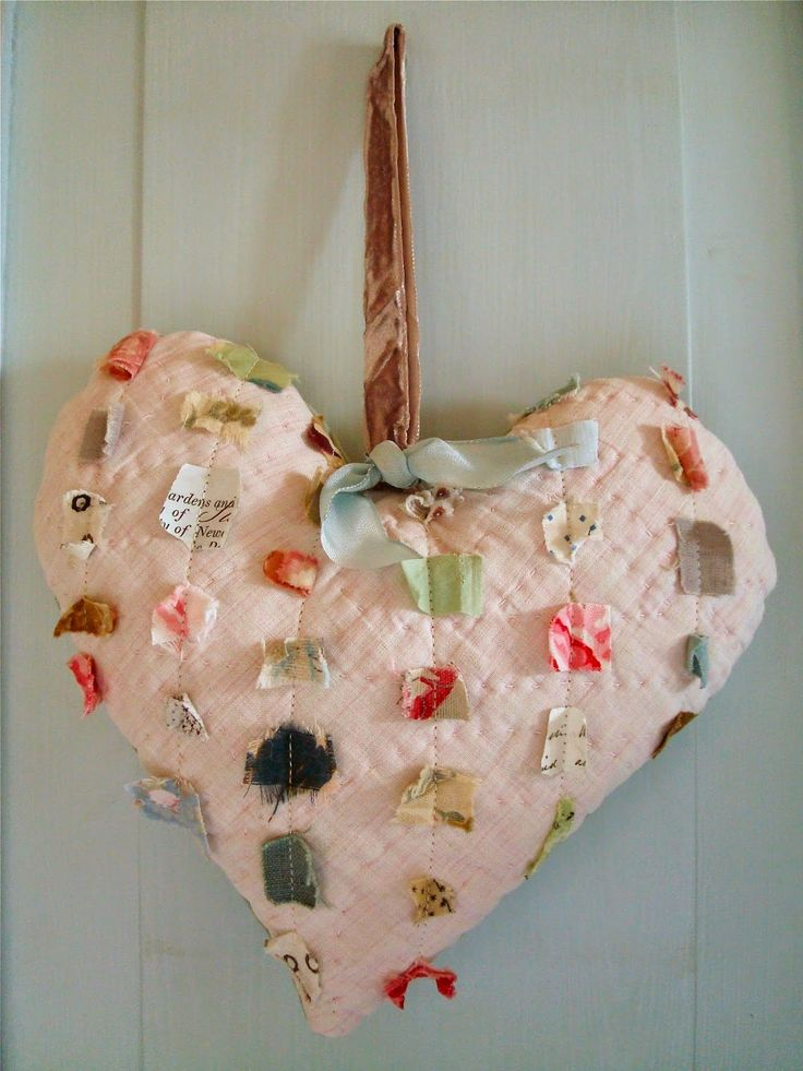 """Hand-stitch tiny fabric scraps onto pre-quilted fabric heart...very rough effect of """"chenille!"""" (Valentines Day craft and decor)"""